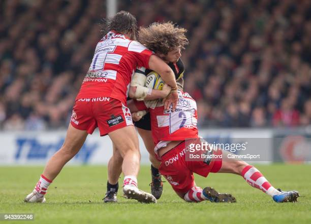 Exeter Chiefs' Alec Hepburn is tackled by Gloucester Rugby's Josh Hohneck and Gloucester Rugby's James Hanson during the Aviva Premiership match...