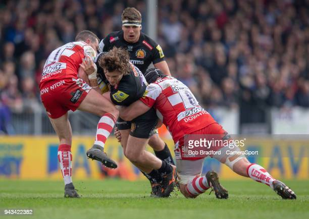 Exeter Chiefs' Alec Hepburn is tackled by Gloucester Rugby's Ruan Ackermann during the Aviva Premiership match between Exeter Chiefs and Gloucester...