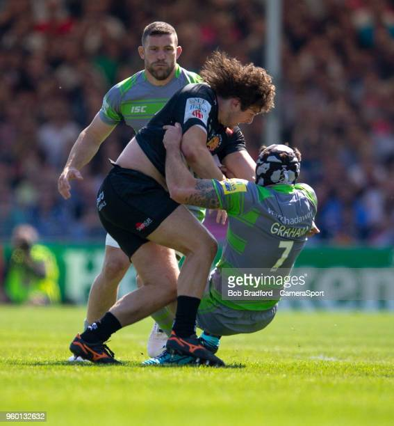 Exeter Chiefs' Alec Hepburn is tackled by Newcastle Falcons' Gary Graham during the Aviva Premiership Semi Final between Exeter Chiefs and Newcastle...