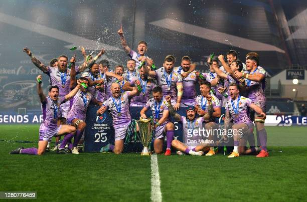 Exeter Chiefs captains Jack Yeandle and Joe Simmonds celebrate with teammates and the Heineken Champions Cup trophy after victory in the Heineken...