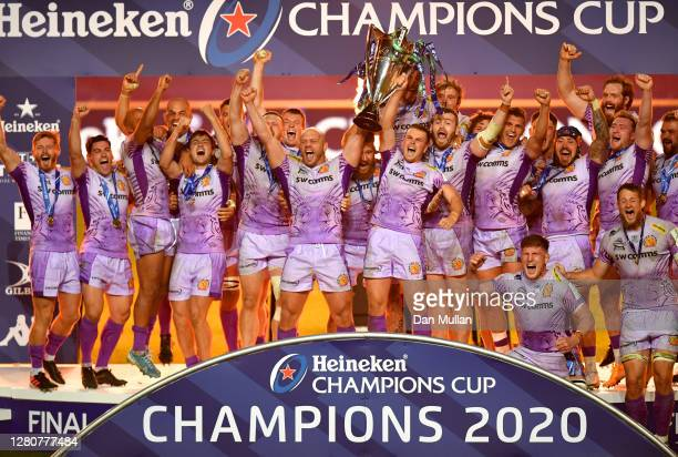 Exeter Chiefs captains Jack Yeandle and Joe Simmonds lift the Heineken Champions Cup Trophy with teammates after victory in the Heineken Champions...