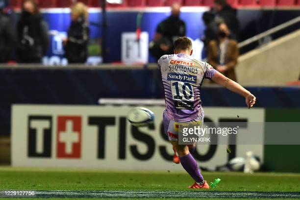Exeter Chiefs' English flyhalf Joe Simmonds kicks the late last penalty during the European Rugby Champions Cup final rugby union match between...
