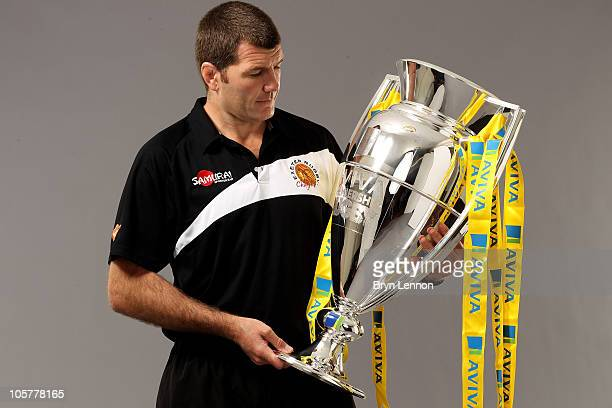 Exeter Chiefs Head Coach Rob Baxter looks admiringly at the Aviva Premiership trophy during the Aviva Premiership Season Launch at Twickenham Stadium...
