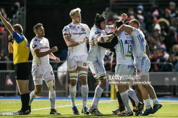 Exeter Chiefs' Ian Whitten celebrates with his team mates after scoring a try during the Aviva Premiership match between Saracens and Exeter Chiefs...