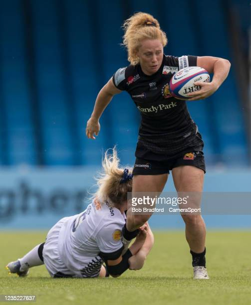 Exeter Chiefs' Jennine Duncan is tackled by Sale Sharks' Vicky A Irwin during the Allianz Premier 15s match between Exeter Chiefs Women and Sale...