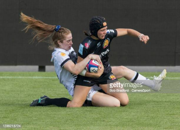 Exeter Chiefs' Merryn Doidge is tackled by Sale Sharks' Lisa Neumann during the Allianz Premier 15s match between Exeter Chiefs Women and Sale Sharks...