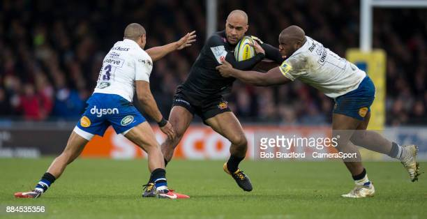 EXETER ENGLAND DECEMBER Exeter Chiefs' Olly Woodburn is tackled by Bath Rugby's Beno Obano and Jonathan Joseph during the Aviva Premiership match...