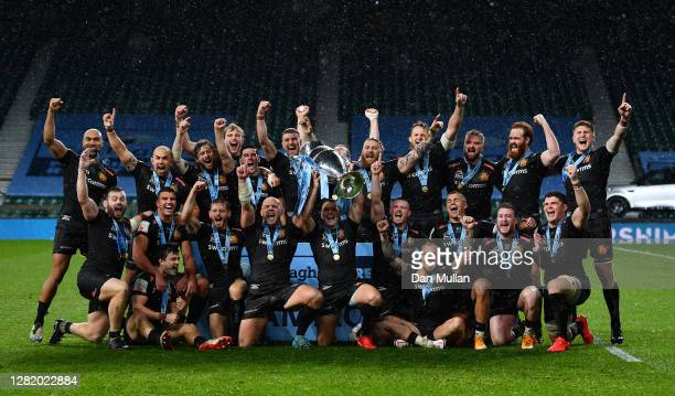 Exeter Chiefs players celebrate with the Gallagher Premiership Trophy following their team's victory in the Gallagher Premiership Rugby final match...