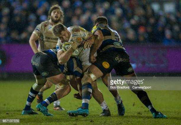 Exeter Chiefs' Sam Hill is tackled by Bath Rugby's Elliott Stooke during the Aviva Premiership match between Bath Rugby and Exeter Chiefs at...