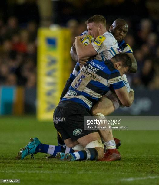 Exeter Chiefs' Sam Simmonds is tackled by Bath Rugby's Elliott Stooke and Beno Obano during the Aviva Premiership match between Bath Rugby and Exeter...
