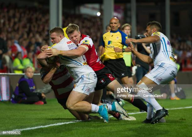 Exeter Chiefs' Sam Simmonds is tackled by Gloucester Rugby's Ollie Thorley during the Aviva Premiership match between Gloucester Rugby and Exeter...
