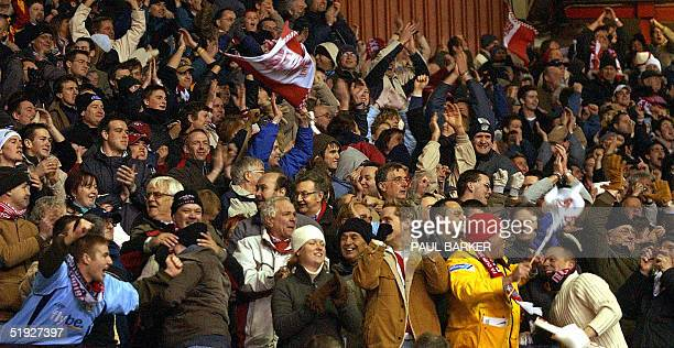 Exeter City fan celebrate after an astonishing scoreless draw against Manchester United during their FA Cup clash at Old Trafford in Manchester 08...