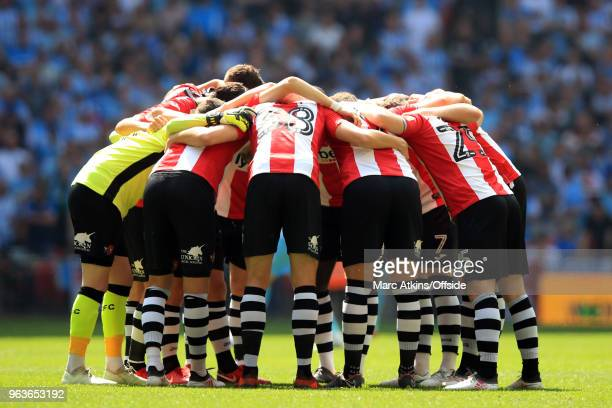 Exeter City players huddle before kick off during the Sky Bet League Two Play Off Final between Coventry City and Exeter City at Wembley Stadium on...