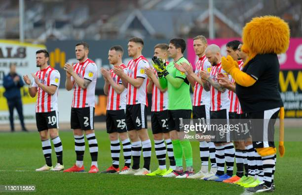 Exeter City players take part in a minute of applause in memory of England's World Cup winning goalkeeper Gordon Banks prior to the Sky Bet League...