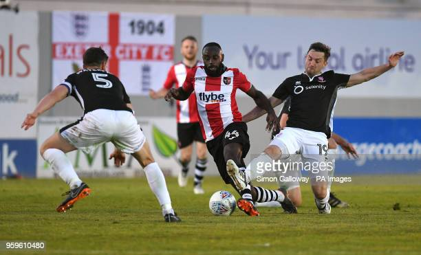Exeter City's Hiram Boateng and Lincoln City's Lee Frecklington battle for the ball during the Sky Bet League Two Playoff match at St James Park...