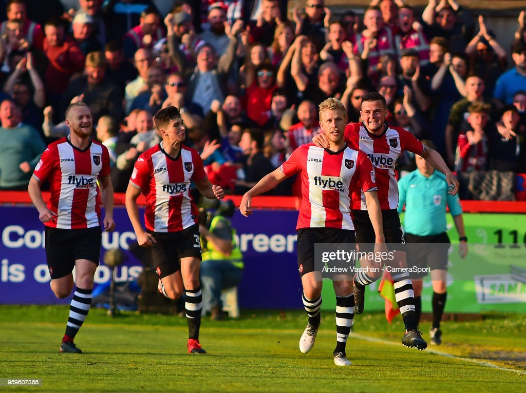 Exeter City's Jayden Stockley celebrates scoring the opening goal with team-mate Pierce Sweeney during the Sky Bet League Two Play Off Semi Final:Second Leg between Exeter City and Lincoln City at St James Park on May 17, 2018 in Exeter, England.