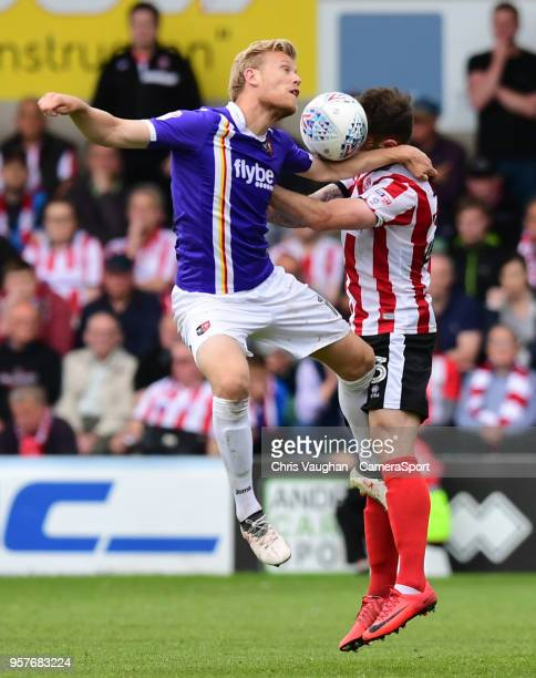 Exeter City's Jayden Stockley vies for possession with Lincoln City's Neal Eardley during the Sky Bet League Two Play Off Semi FinalFirst Leg between...