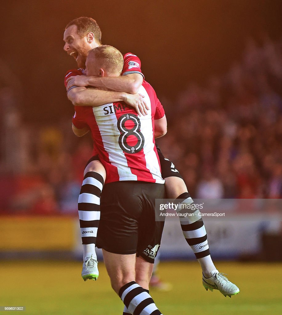 Exeter City's Ryan Harley celebrates scoring his sides third goal with Robbie Simpson, right, during the Sky Bet League Two Play Off Semi Final:Second Leg between Exeter City and Lincoln City at St James Park on May 17, 2018 in Exeter, England.