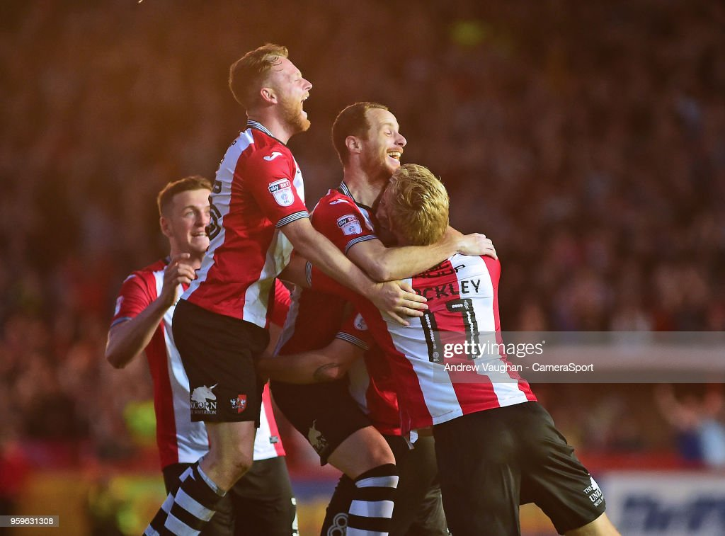 Exeter City's Ryan Harley celebrates scoring his sides third goal with team mates during the Sky Bet League Two Play Off Semi Final:Second Leg between Exeter City and Lincoln City at St James Park on May 17, 2018 in Exeter, England.