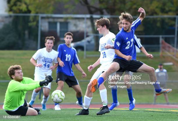 Exeter goalkeeper Owen DiGuardi and Shawn Lee defend against Oley Valley's Riley Schlegel . The Oley Valley Lynx defeat the Exeter Eagles 2-0 at Gov....