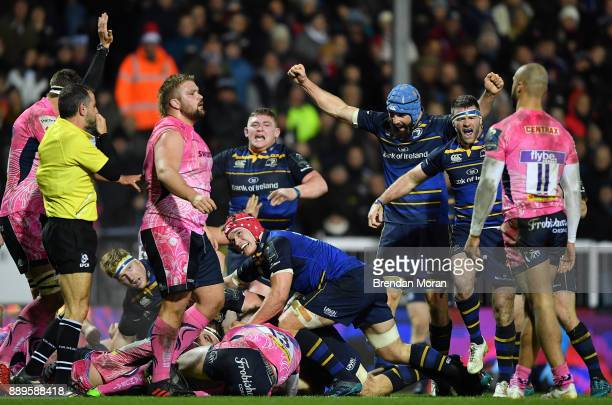 Exeter United Kingdom 10 December 2017 Leinster players celebrate a try scored by Jack Conan hidden and signalled by Referee Romain Poite during the...