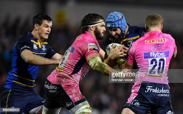 Exeter United Kingdom 10 December 2017 Scott Fardy of Leinster is tackled by Don Armand and Sam Simmonds of Exeter Chiefs during the European Rugby...