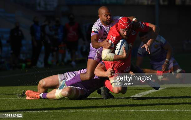 Exeter wing Tom O' Flaherty and Sam Simmonds combine to thwart Toulouse forward Alban Placines just short of the goalline during the Heineken...