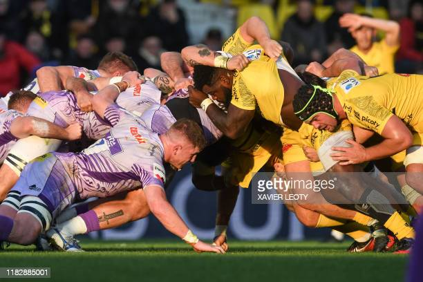 Exeter's and La Rochelle's players engage in a scrum during the first round of the European Rugby Champions Cup match between La Rochelle and Exeter...