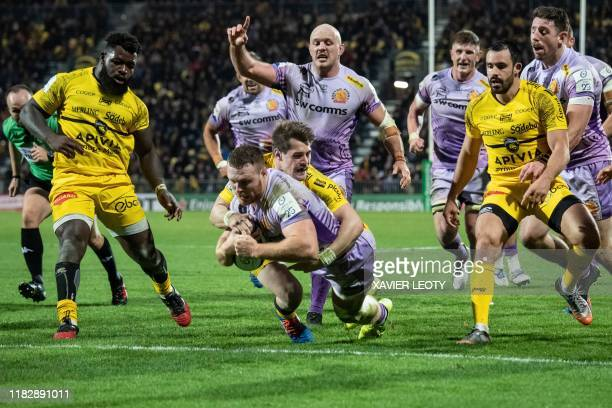Exeter's English number 8 Sam Simmons scores a try during the first round of the European Rugby Champions Cup match between La Rochelle and Exeter...