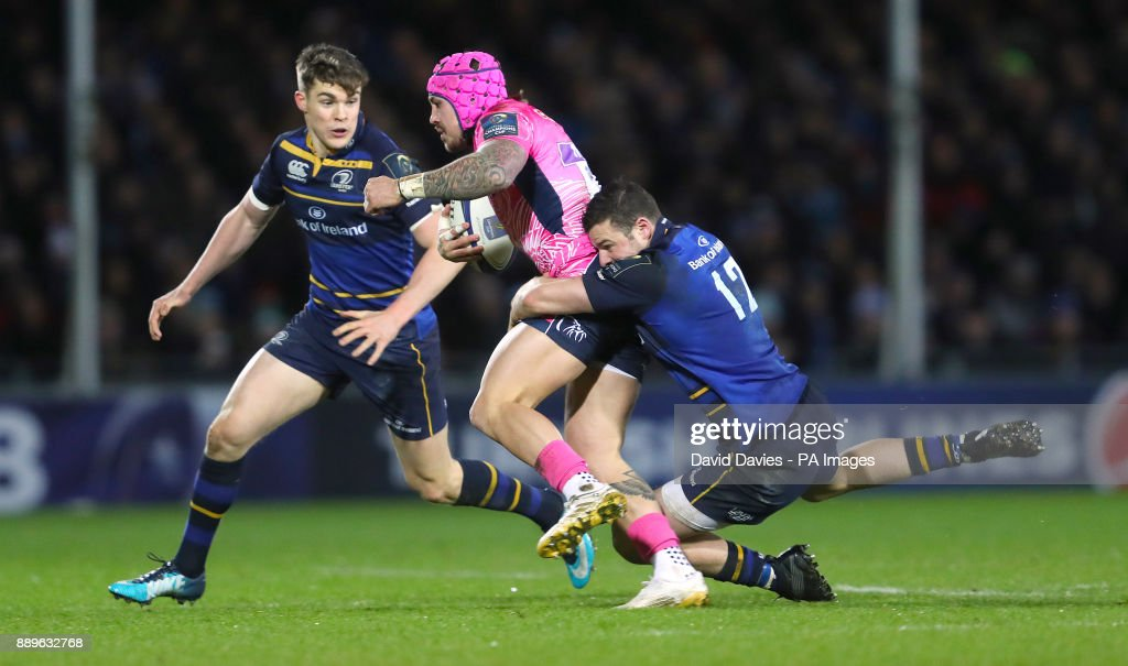 Exeter's Jack Nowell is tackled by Leinster's Robbie Henshaw during the European Rugby Champions Cup, Pool Three match at Sandy park, Exeter.