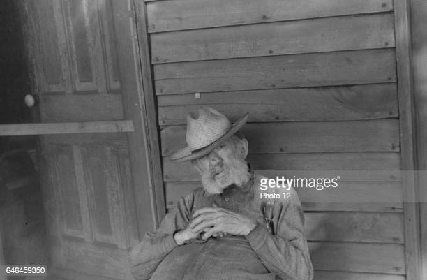 Exfarmer resting by a house in Circleville Ohio's 'Hooverville' 1938