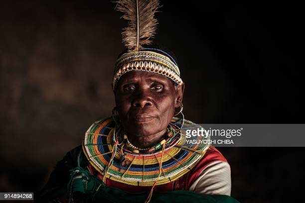 Ex-female genital mutilation cutter of the Pokot tribe Chepchai Limaa poses in the abandoned cave where girls rested to heal after their...