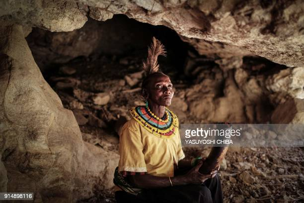 TOPSHOT Exfemale genital mutilation cutter of the Pokot tribe Chepchai Limaa poses in the abandoned cave where girls rested to heal after their...