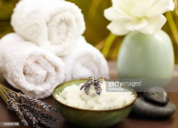 exfoliation salt scrub at spa with lavender - exfoliation stock pictures, royalty-free photos & images