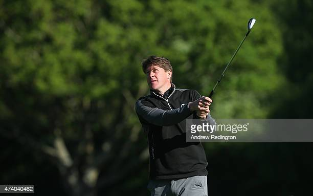 ExFootballer Darren Anderton hits an approach shot during the ProAm ahead of the BMW PGA Championship at Wentworth on May 20 2015 in Virginia Water...