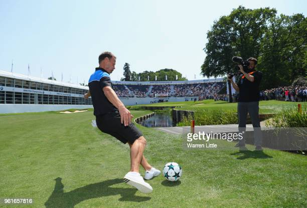 Exfootballer Teddy Sheringham takes part in a football golf challenge on the 18th hole during the BMW PGA Championship Pro Am tournament at Wentworth...