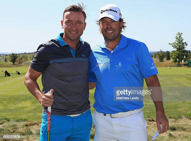 Exfootballer Vladimir Smicer pictured with Mikael Lundberg of Sweden during a practice round ahead of the DD Real Czech Masters at Albatross Golf...