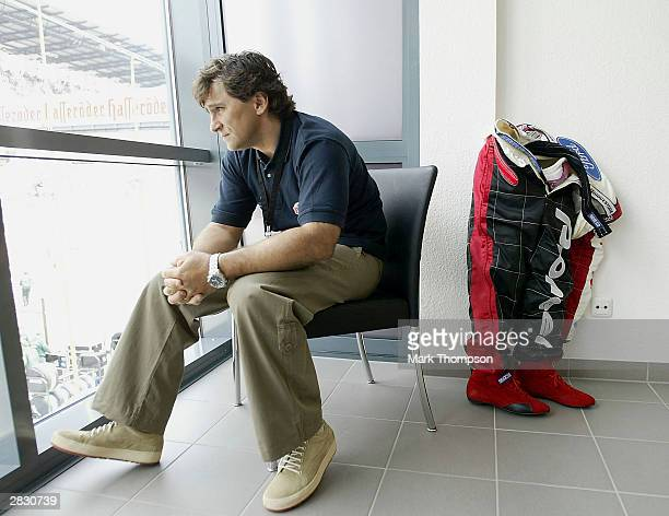 ExFormula 1 and CART racing driver Alex Zanardi of Italy relaxes before he prepares to drive in his specially adapted Cart for his disability caused...