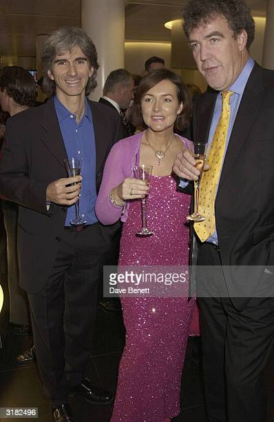 ExFormula One racing driver Damon Hill with his wife Georgie and TV presenter Jeremy Clarkson at a 'Tommy's Charity' party on 24th November 2002 The...