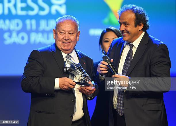 ExFrance international footballer Just Fontaine receives the Adidas Platinum Boot award from UEFA President Michel Platini during the Opening...