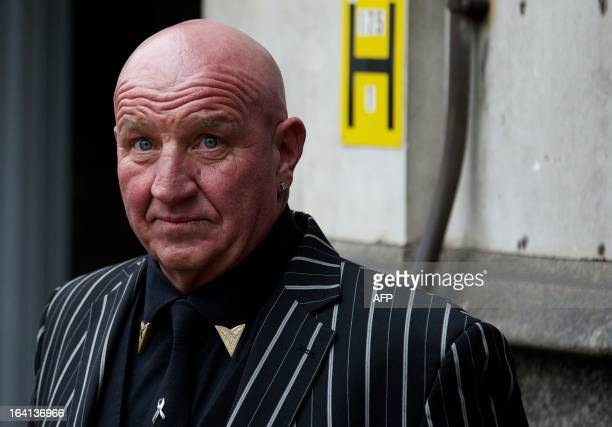 Ex-Gangster turned author Dave Courtney looks on as he arrives to attend the funeral of the mastermind of the 1963 Great Train Robbery, Bruce...