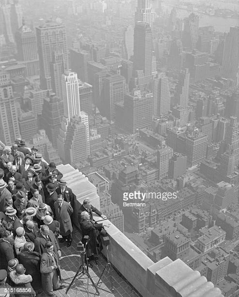 ExGovernor Alfred E Smith Governor Franklin D Roosevelt and others at the top of the Empire State Building tallest in the world gazing out over the...