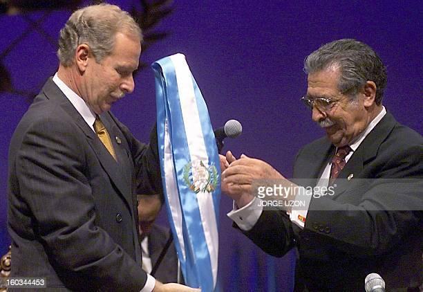 Ex-Guatemalan President Alvaro Arzu hands the presidential band to president-elect of the Guatemalan Congress General Efrain Rio Montt 14 January...