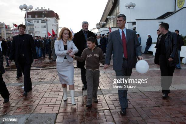 Exguerrilla commander Hashim Thaci and leader of the opposition Democratic Party of Kosovo leave with his wife and their son after a rally on...