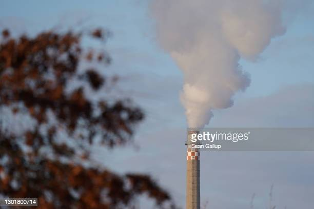 Exhaust emerges from the smokestack of a natural-gas fired power plant in the city center on February 10, 2021 in Berlin, Germany. Germany is seeking...
