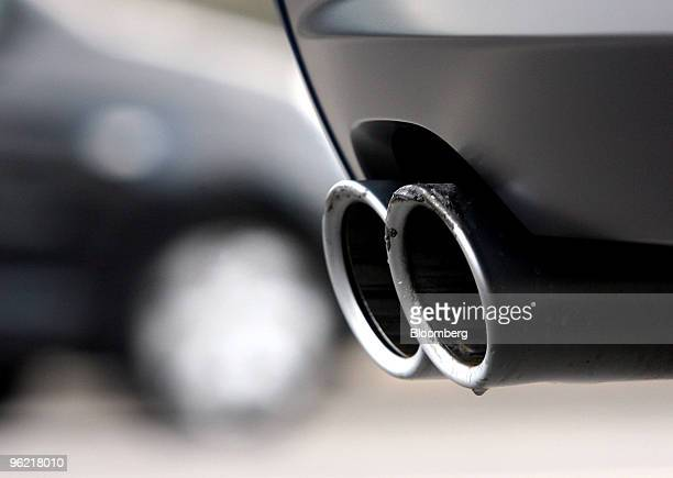 Exhaust emissions come from a tailpipe as the car sits in traffic in London UK on Tuesday March 4 2008 Chancellor of the Exchequer Alistair Darling...