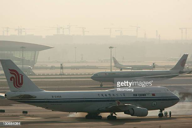 Exhaust emits from a jetengine on an Air China Ltd airplane burning a mixture of jet fuel and bioliquid fuel at Beijing Capital International Airport...