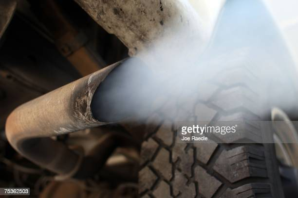Exhaust flows out of the tailpipe of a vehicle at 'Mufflers 4 Less' July 11 2007 in Miami Florida Florida Governor Charlie Crist plans on adopting...