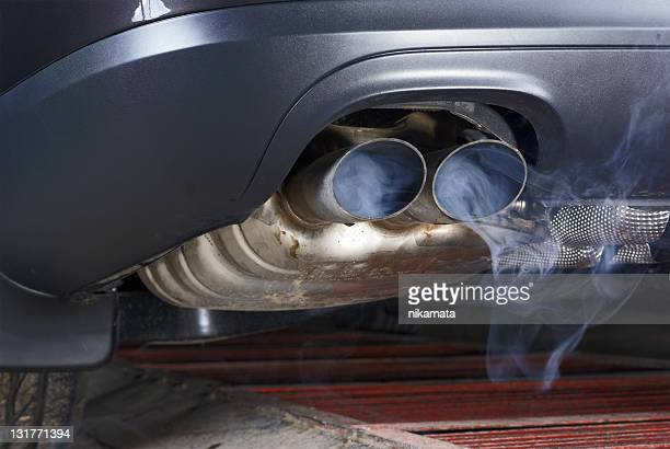 exhaust pipe of a car - blowing out the pollution. - carbon dioxide stock photos and pictures