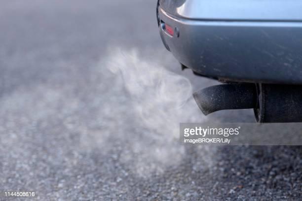 exhaust pipe of a passenger car with exhaust gases, diesel engine, baden-wuerttemberg, germany - smog stock-fotos und bilder